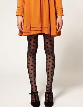 Love this: orange swing dress, black polkadot tights and black t-strap heels