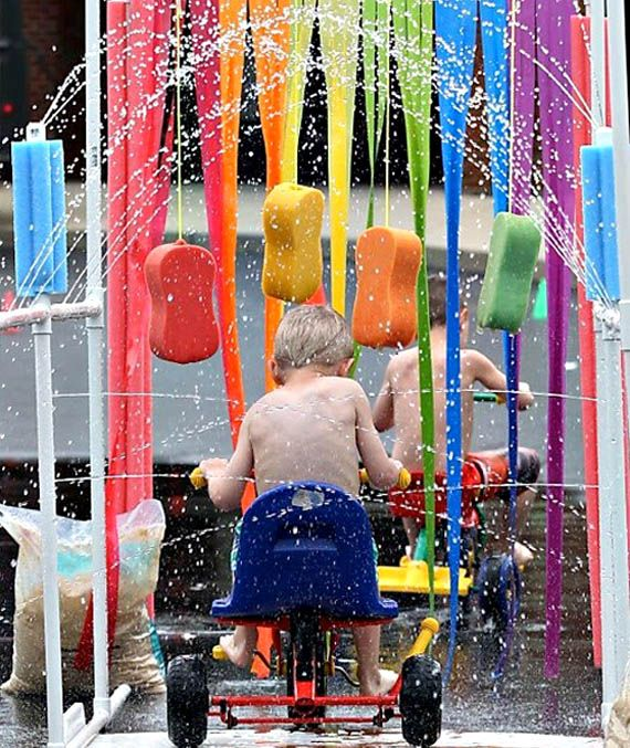 Why in the world aren't I pedaling my bike through one of these right now?! Kiddy car wash, brilliant!