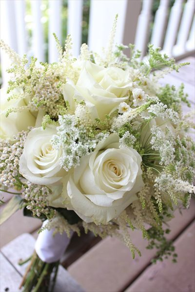 An all white boquet featuring gorgeous roses, astilbe and Queen Anne's lace is perfect for a romantic weeding