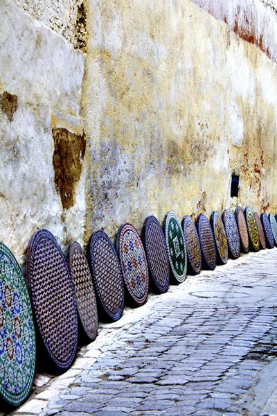 Africa |  Ceramic table tops for sale  ~ Street Gallery in Fes, Morocco | ©  Asli Alin