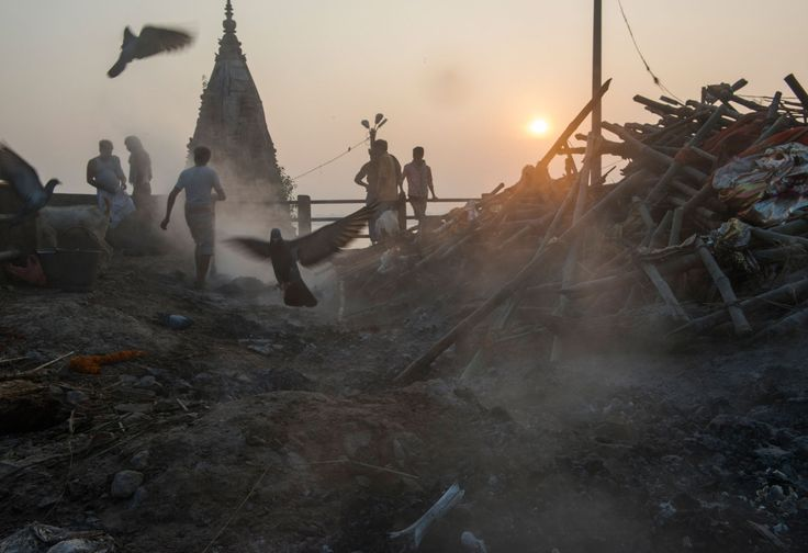 Picture of smoke rising from the remnants of a funeral pyre in Varanasi