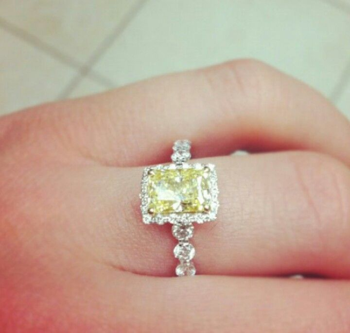 Canary diamond yellow diamond ring with diamond halo and shank