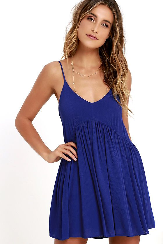 Is this real life? The Dream State Royal Blue Babydoll Dress has arrived and we can't believe our eyes! From adjustable spaghetti straps, lightweight woven rayon swings to a rounded neckline, and babydoll bodice with shift silhouette. Slender strap graces the open back.
