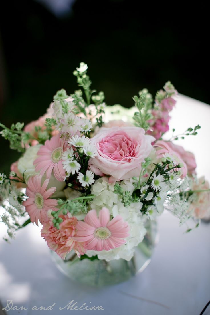 Pink daisies & roses with white hydrangea and Monte casino aster.