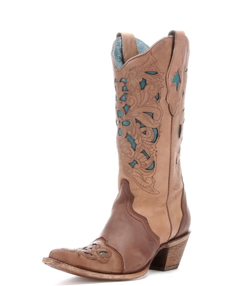 """This contemporary cowgirl's Corral boot is handcrafted in Leon, Guanajuato, Mexico by some of the most experienced boot makers in the country. Features a brown leather foot under a decorative 12"""" matching leather shaft. Distressed, laser tooled overlay with turquoise-hued inlays.**If you are unsure of your size for Corral boots, you might want to go a half size bigger.**"""
