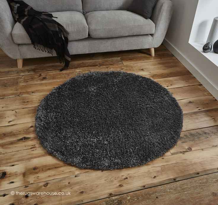 Vista Dark Grey Circle Rug, a dark grey modern shaggy rug that is soft to the touch 100% polypropylene, machine-woven, 133cm (4ft4' Circle)) http://www.therugswarehouse.co.uk/round-rugs/vista-circle-rugs/vista-dark-grey-circle-rug.html