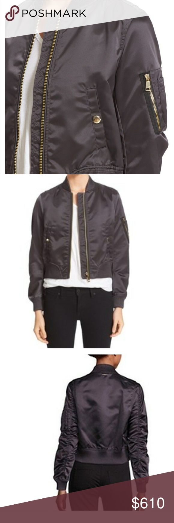 Burberry bomber jacket New without tags.  Never worn, perfect condition.  The Size is a US 8, a tiny bit big on me.   color is graphite and sold out.  Beautiful gold buttons on pockets and zipper. Burberry Jackets & Coats