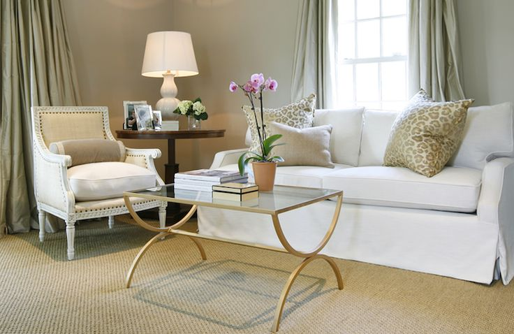 chic modern-french design.  gray walls pale seafoam silk drapry panels, white slip-covered sofa, oly studio hanna linen chair, matte-gold patina cocktail table with sisal rug.    ashley goforth design.