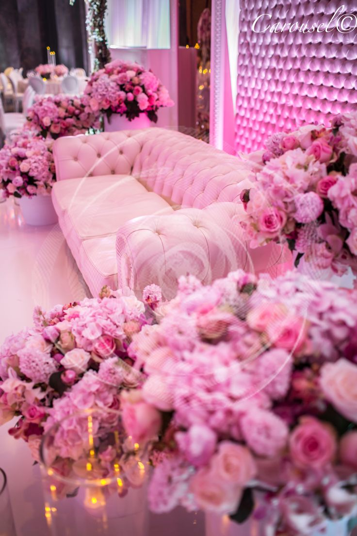 Gorgeous Wedding Couch with Bouquets of Pink Roses