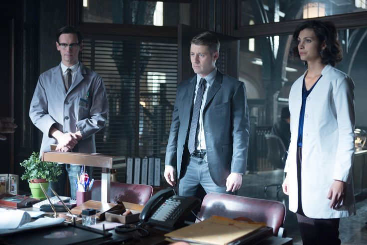 """#Gotham This is why you shouldn't date your co-workers?! """"GOTHAM: L-R: Edward Nygma (Cory Michael Smith), Detective James Gordon (Ben McKenzie) and Dr. Leslie Thompkins (guest star Morena Baccarin) have information for Captain Essen in the """"The Blind Fortune Teller"""" episode of GOTHAM airing Monday, Feb. 16 (8:00-9:00 PM ET/PT) on FOX. ©2015 Fox Broadcasting Co. Cr: Jessica Miglio/FOX"""""""