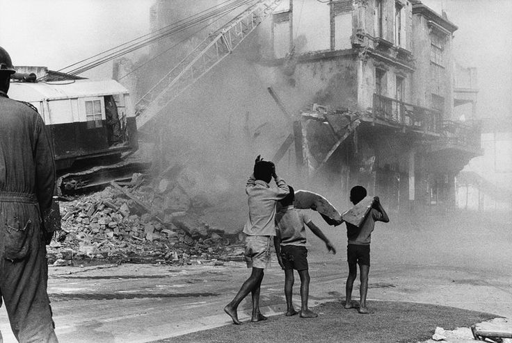 Boys watching destruction of District Six, South Africa, 1974. From a collection of images by Paul Alberts.