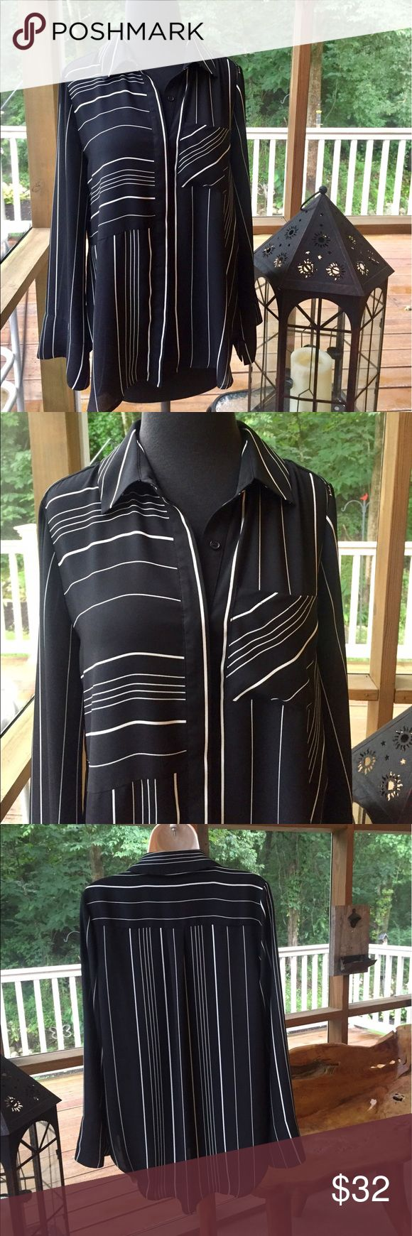 """Neumann Marcus Long Sleeve Button Down Top SMALL This elegant Neiman Marcus top looks and feels like silk but it isn't!  It is 100% polyester that is machine washable.  I love the varied geometric patterns in this black and white shirt.  The sleeves have a more open bell shaped cuff.  This is a size SMALL but it seems roomier.  It could fit a medium.  Check the measurements.  It measures 20.5"""" armpit to armpit.  It measures 29"""" down center back.  The sleeves measure 24"""" from top seam to…"""