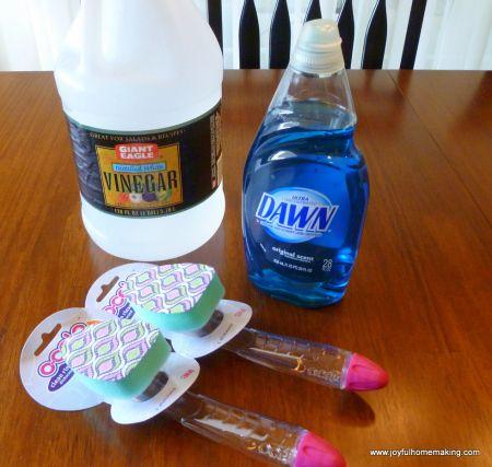 Simple Shower & Tub Cleaner: Fill the scrubber  half & half - Vinegar and Dawn.