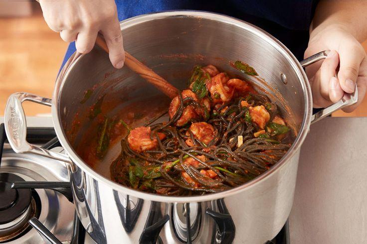 Squid-ink pasta in tomato sauce with shrimp