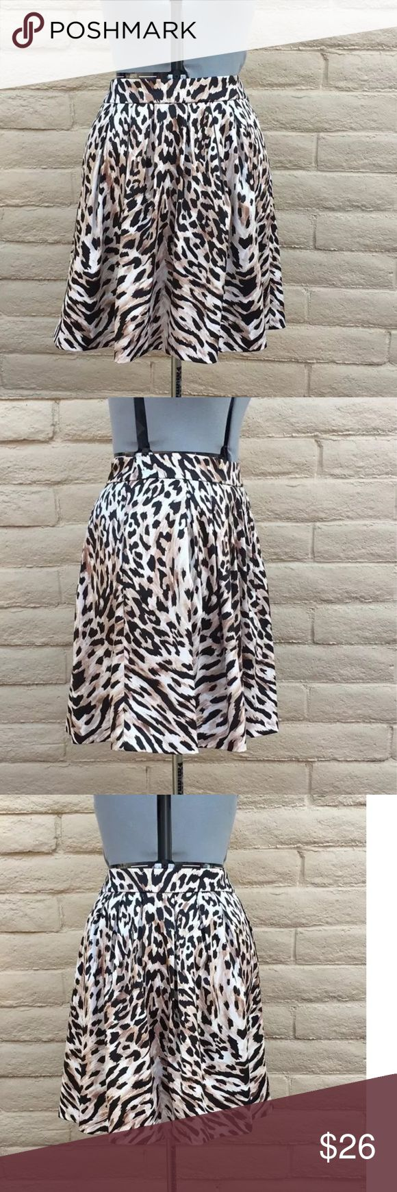 White House black market cheetah skirt SZ 8 Gorgeous skirt. Like new.  No stains or tears. Side zipper, and pockets.  Polyester spandex blend. Has weight to it. Fully lined. Great for career or evening out with a dressy top. 15.25 across waist 21 inch long White House Black Market Skirts Midi