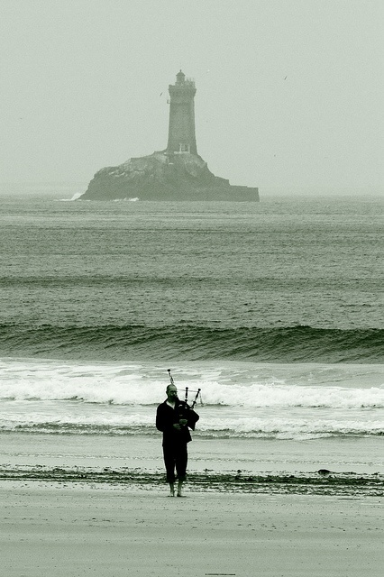 Piper (bagpipes) on the beach in Breizh. (Brittany, Celtic, Bretagne, France)