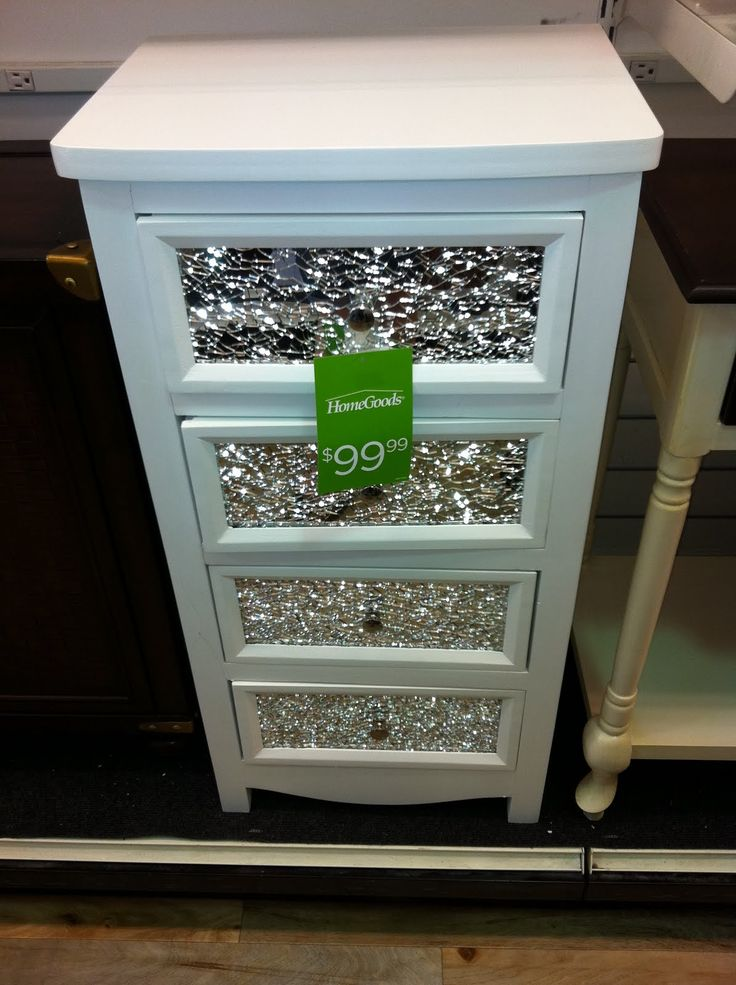 Love the broken mirror covered drawers!