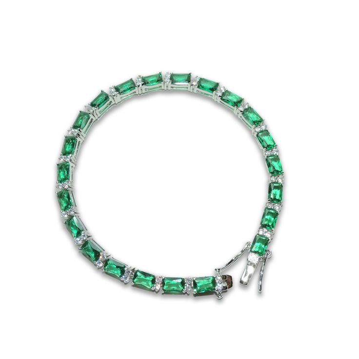 Magnificent Emerald colored 5A Grade CZ stones on a tasteful tennis bracelet (.925 Sterling Silver finished in Rhodium)