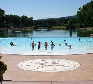 The Broadmoor, Colorado Springs, CO. An 11,000-square-foot infinity-edge pool backed by Cheyenne Lake. Twin water slides + Cabanas.