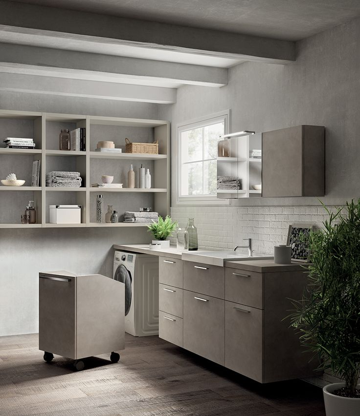 The matching shade between the Azimut laminate top and the Decorative Melamine base units adds value and elegance to the laundry room. The introduction of mobile elements together with an impeccable distribution of functions makes these settings - which are usually considered mere work spaces - both flexible and functional.