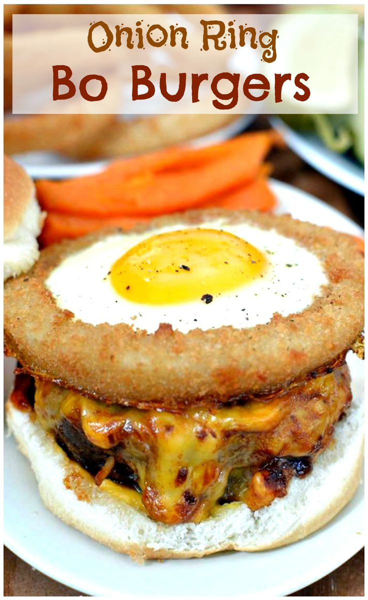 Savory beef mixed with diced onions grilled to perfection, topped with homemade BBQ sauce, melted cheese, & a fried egg surrounded by a crispy onion ring. #Burgers