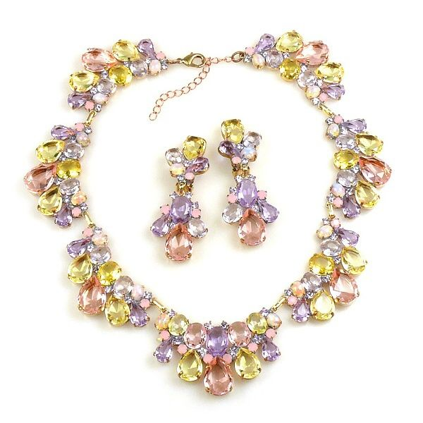 "Wonderful colored link rhinestone necklace with earrings. Length of necklace 15.00"" and extension 2.50"", clips earrings 2.75"""