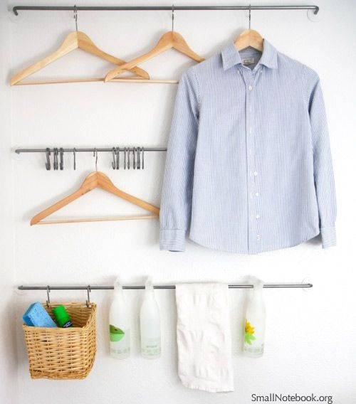 Laundry Room Organization - wall organizer via Small Notebook I'm in love, ikea towel racks for hanging laundry & cleaning supplies.