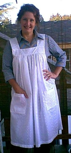 Victorian pinafore style apron from white eyelet.                                                                                                                                                     Más