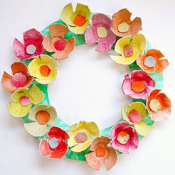 Egg-straordinary Egg Carton Flower Wreath: What You'll Need: 2 egg cartons; scissors; 8-color set of watercolor paints; paintbrushes; small container; scrap paper; paper plate; glue; length of ribbon or wreath hanger