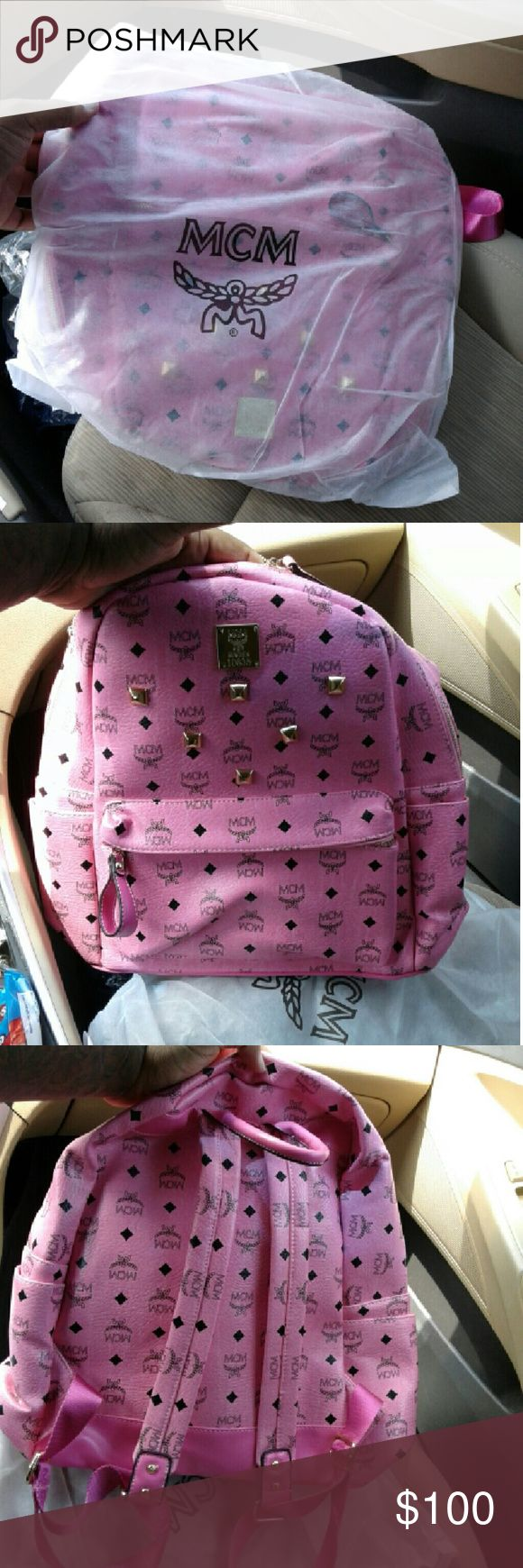 Pink MCM Backpack Here you have is a brand new mcm backpack!! Brand new!!! Never been worn!!! Hurry up and buy!!! MCM Bags Backpacks