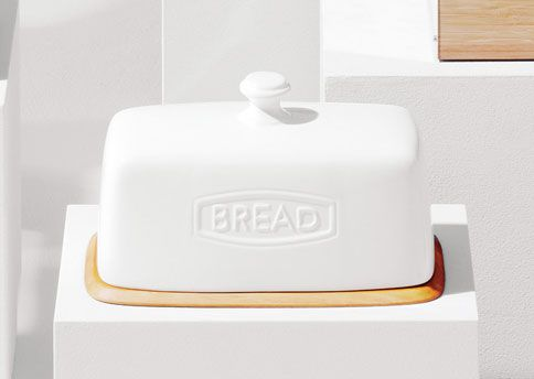 """COUNTRY STRONG  Sturdy stoneware that holds a single loaf or a bunch of bagels.  """"Rhodes"""" bread box, $59; potterybarn.com"""