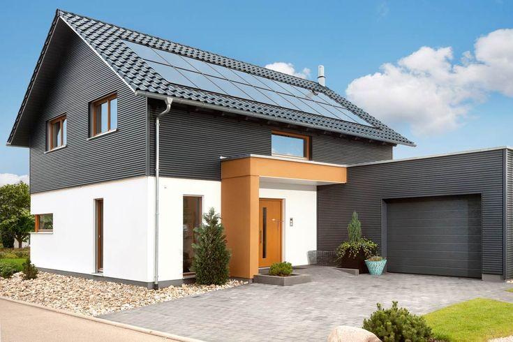 Kompaktes Plus-Haus: mit ins Dach integrierter Photovoltaik, Lüftungs-Anlage mit Sole Erdwärmetauscher, Batteriespeicher und Lademöglichkeit für Elektroautos. Foto: SchwörerHaus