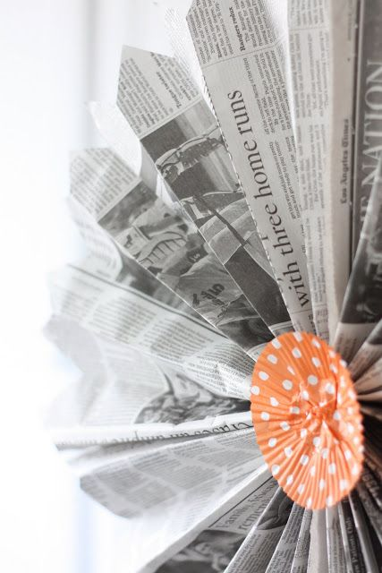 newspaper fan style pinwheels with cupcake wrappers as centers