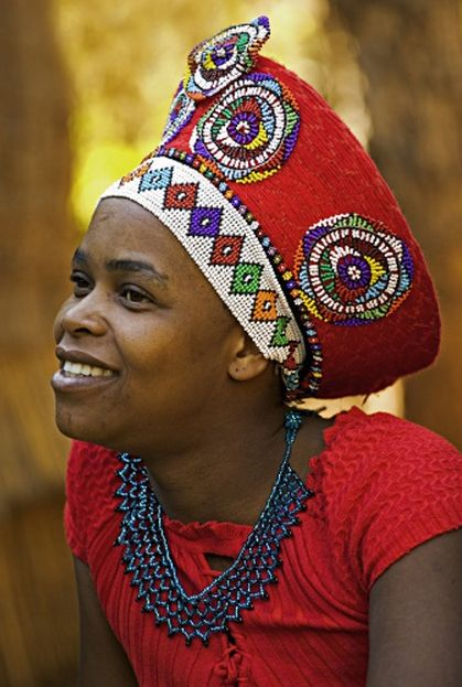 Africa | Zulu woman in traditional red headdress of a married woman. Lesedi Cultural Village near Johannesburg, South Africa. | ©Martin Harvey