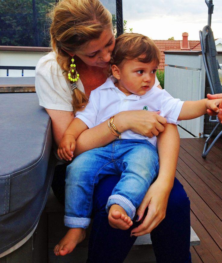Founder Charlotte Bakke with her son, wearing fabulous neon yellow earrings from Isharya
