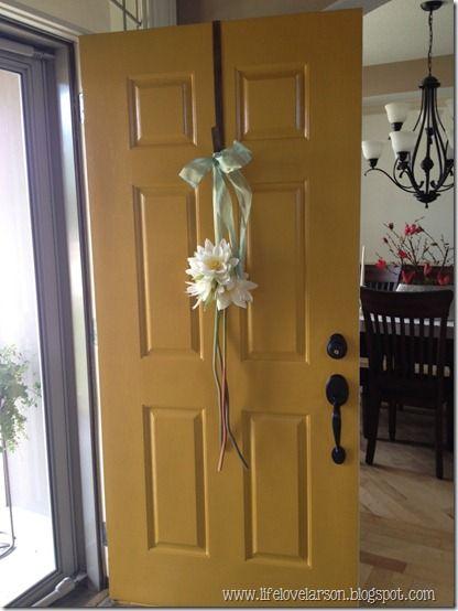 """Mustard yellow front door. """"Golden Leaf"""" by Behr."""