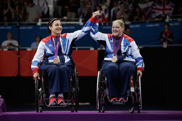 Bronze medallists Jane Campbell of Great Britain (L) and Sara Head of Great Britain (R) wave from the podium during the medal ceremony for the Women's Team Table Tennis - Classes 1-3 on day 9 of the London 2012 Paralympic Games at ExCel on September 7, 2012 in London, England.