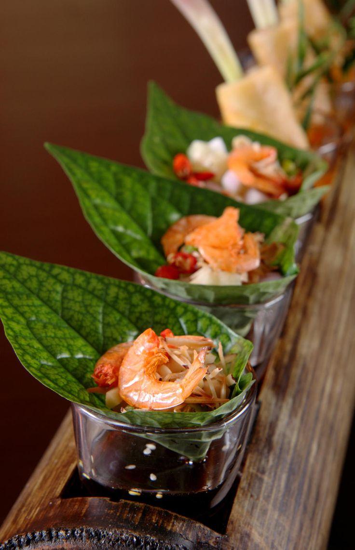 a traditional Thai snack, Miang Kham, at Ritz Carlton Phulay Bay