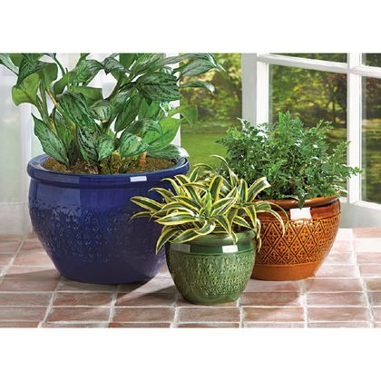 Bring a burst of color to your garden! Embossed earthenware flower pots are sumptuous in shades of azure, topaz and peridot. Set includes three separate sizes to hold a variety of your favorite greenery! Drain hole at bottom of each pot. <br />