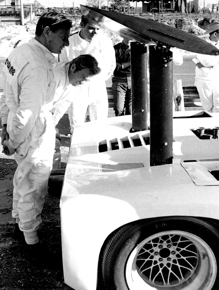 1966 Can-Am Race Cup - Group 7 Sports Car Races 1966 Chaparral 2E - Chaparral Cars - US Racing Team which built race cars from 1963 -1970 - Bruce McLaren checks out Jim Hall's Chaparral.