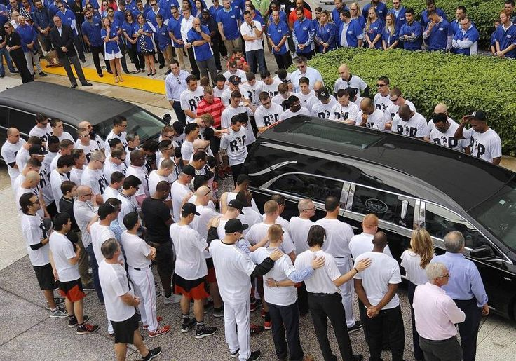 Marlins players, including president of the Miami Marlins, David Samson, center, stand in silence as they paid their respects to teammate Jose Fernandez prior to the hearse departing Marlins Park on Wed., Sept. 28, 2016.
