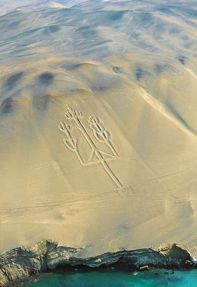 Pre-Inca Nazca - The Paracas 'Trident' or 'Candelabra' is a huge cactus-shaped figure carved into a hillside at Pisco Bay on the Peruvian coast.