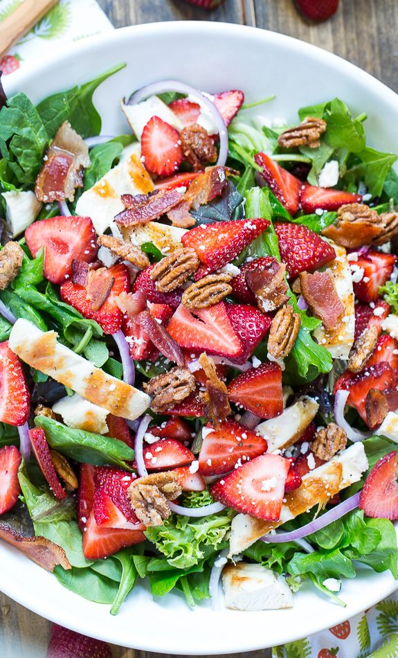 Strawberry Fields Salad is bursting with sweet, tart, and salty flavors. Bacon, feta cheese, red onion, glazed pecans and grilled chicken.