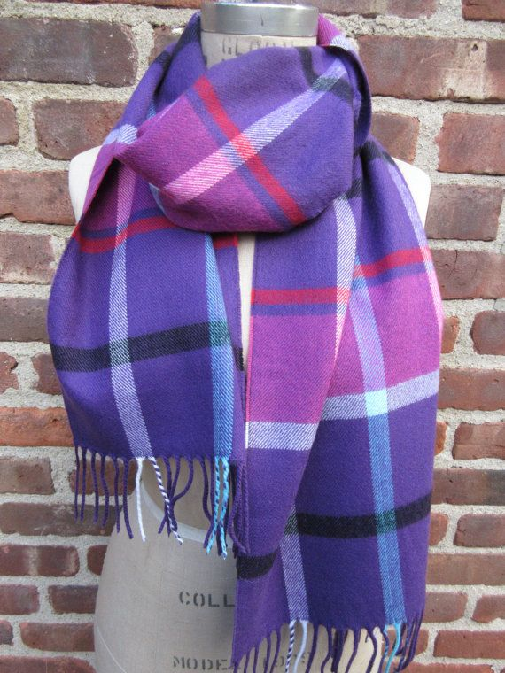 Colorful purple plaid flannel fringed scarf, cozy warm winter neck wrap, muffler Scarf has a purple background with a colorful pattern in shades red, light blue, pink, black and white Scarf measures 65 long, not including the fringe by 12 wide  Handmade in a super soft combed acrylic  Hand wash, line dry or dry clean  Thank you for looking  If shipping is overcharged it will be refunded