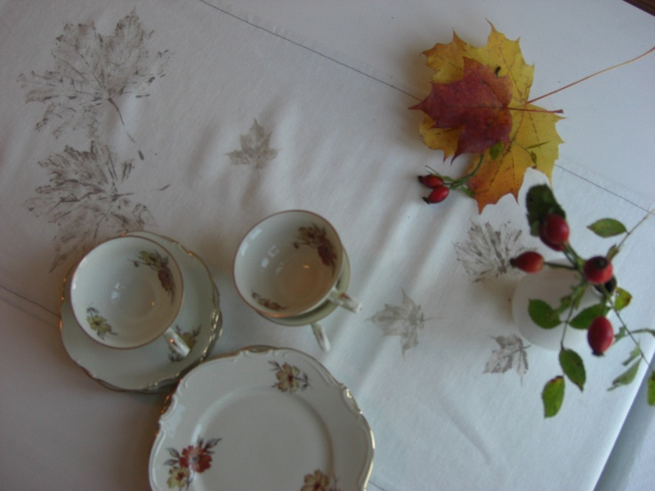 With cups and autumn leaves.