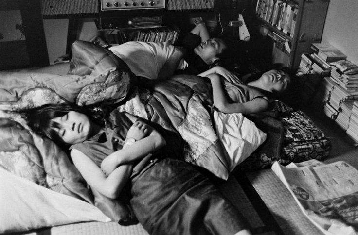 """TEENAGE WASTELAND: JAPANESE YOUTH IN REVOLT, 1964 — Michael Rougier — Caption from original story in Sept. 11, 1964, issue of LIFE: """"[Yoko] often ends her long nights sprawled on a futon in a friend's room."""""""