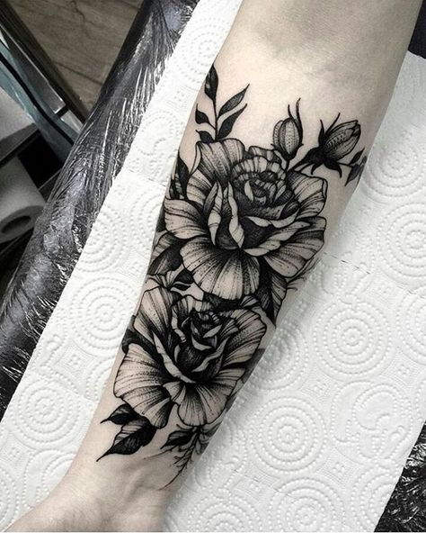 Blackwork floral forearm tattoo by  @dmitriy.tkach