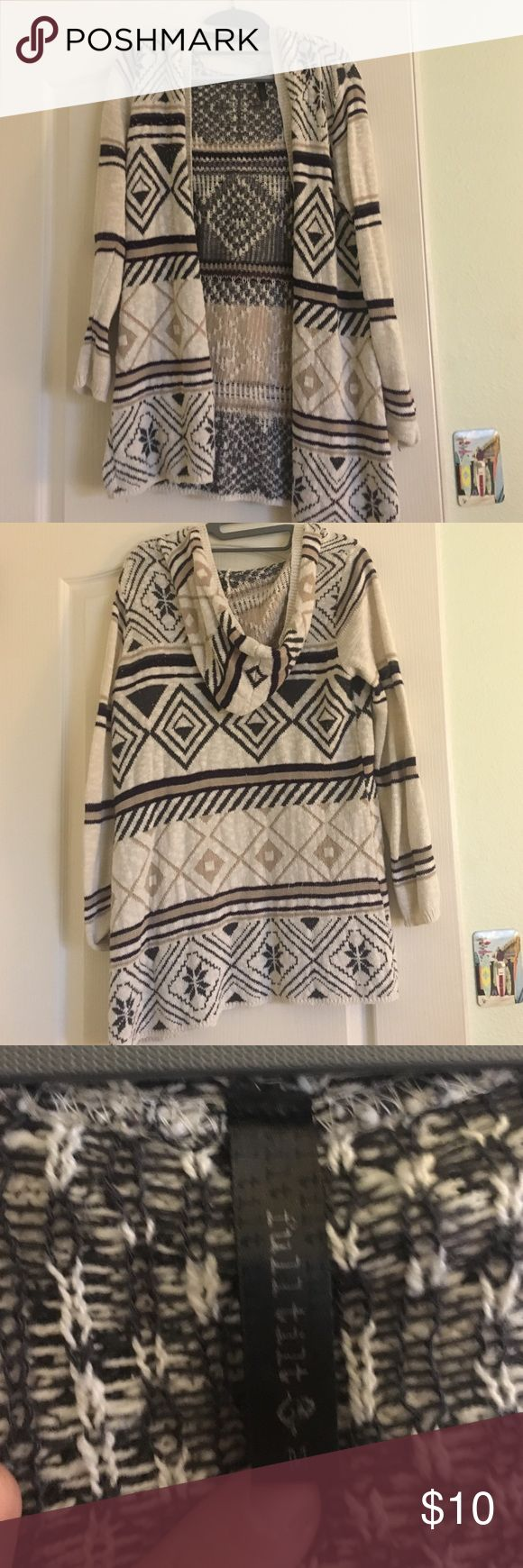 Tribal, warm cardigan! Warm tribal cardigan with a good in the back. Very cute, not too heavy or bulky at all. Made of 60% cotton and 40% acrylic. Full Tilt Sweaters Cardigans