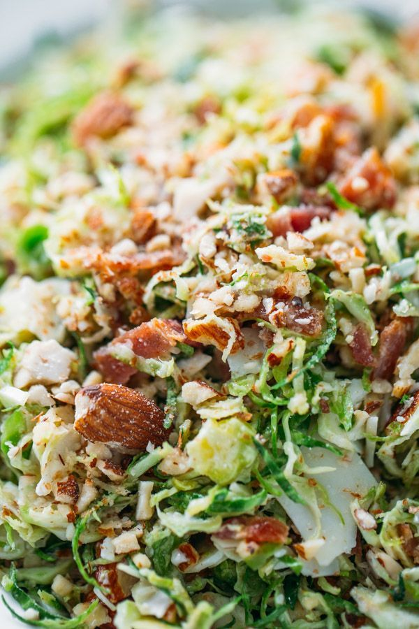 Bacon and Brussels Sprout Salad - I bring this to holiday meals every year and it is always everyone's favorite! Bacon, almonds, Parmesan, light citrus vinaigrette, and paper-thin brussels sprouts!