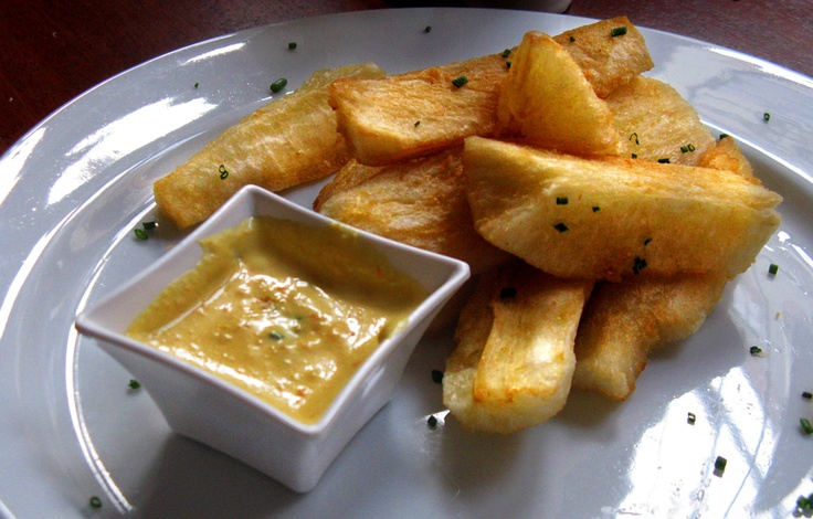 south american food - fried yucca root with spicy dipping sauce.